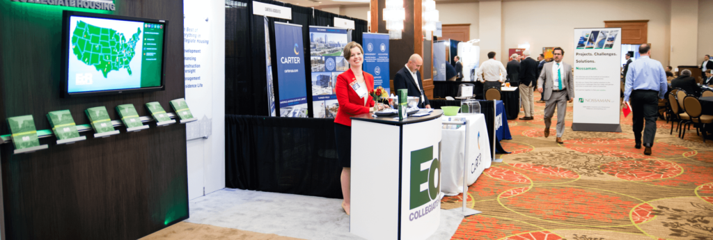 woman standing at exhibit booth