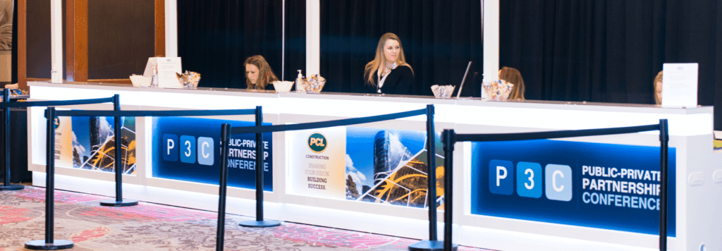 Employees working at a registration desk